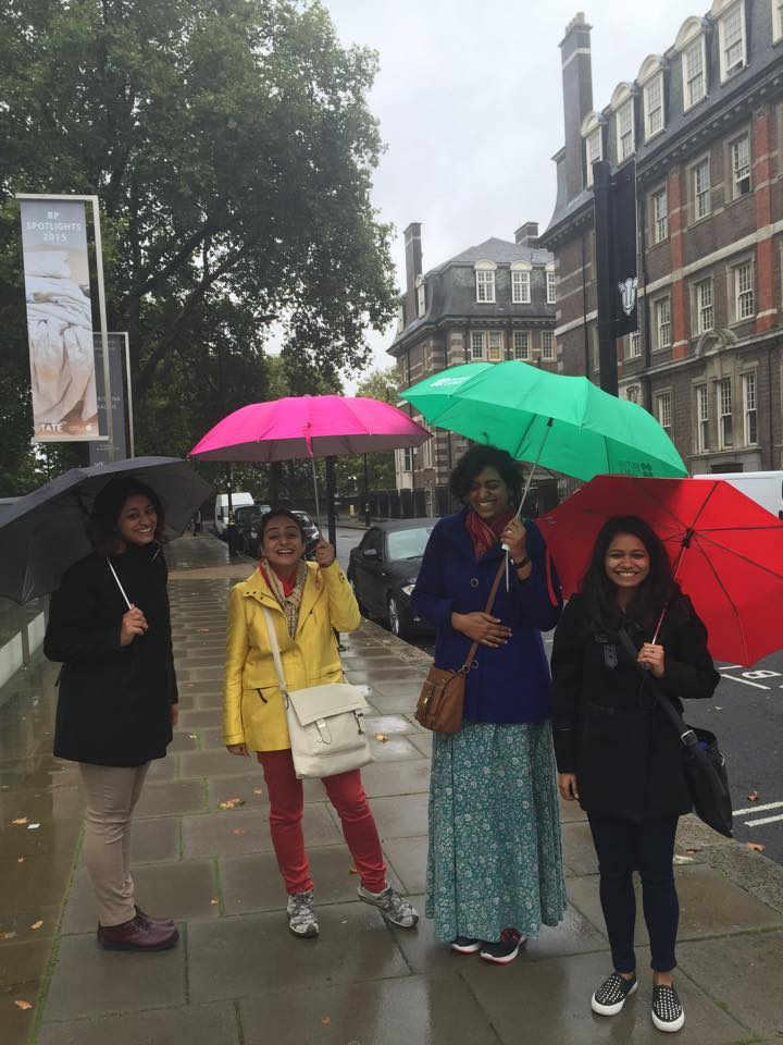 Happy visitors with colourful umbrellas. Copyright: Poulomi Das