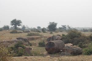 The incomplete sandstone boulders strewn around