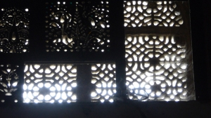 Detail of a carved window near the ceiling of the dome