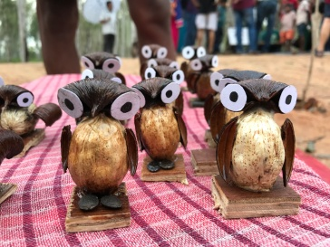 Owls crafted of apricot shells