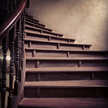 Winding up grand wooden stairs of a building at DN Road