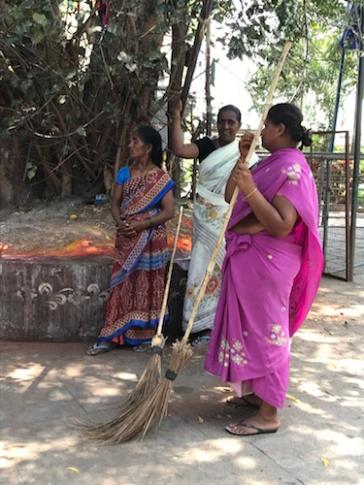 Sweepers standing at the sidelines. Amareshwara Temple, Amaravati, Andhra Pradesh