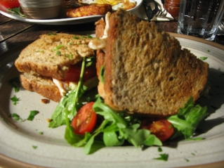 Bacon & cheese sandwich with cherry tomatoes & rocket leaves